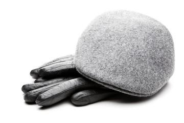 Tweed grey cap black leather gloves white background