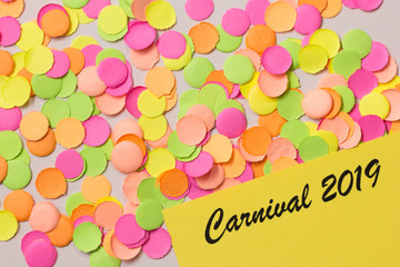 Carnaval party background concept. Space for text, copyspace. Written the words:  Carnival 2019. Colorful confetti