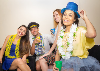 Friends are at a party. Celebrating the Brazilian Carnaval. Tourists are posing for the photo..