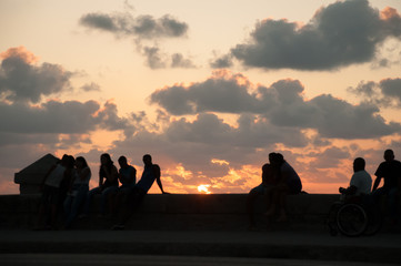 people resting at sunset in the Malecon. Havana. Cuba