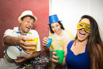 Revelers making funny photo. Group of friends celebrate the Carnaval in Brazil..
