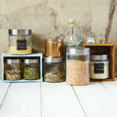 Arrangement of dry food products and kitchen utensils in the kitchen