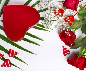Red roses, gift box and heart shapes cookies on white background. Valentines day background