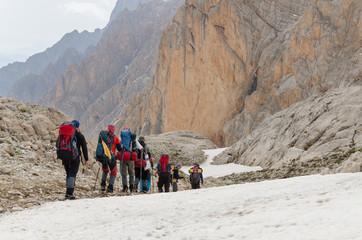 A group of mountaineers descending from the mountain pass. Turkey, Central Taurus Mountains, Aladaglar (Anti Taurus).