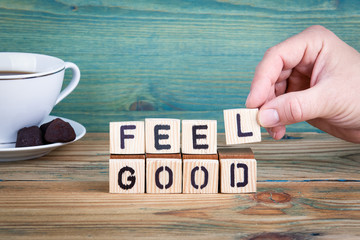 feel good. Wooden letters on the office desk, informative and communication background.