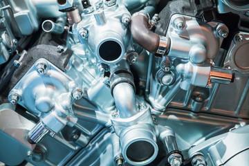 V12 car engine fragment, closeup photo