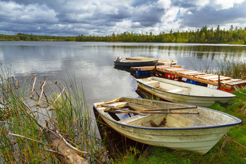 Idyllic lake scenery with boats in cloudy day, Sweden