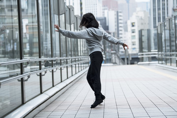 Dancer is practicing the choreography in the city