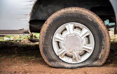 Flat tire on mud road