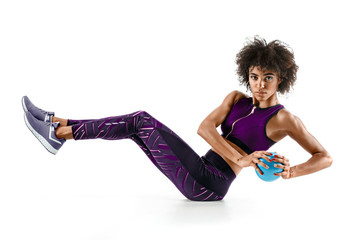 Beautiful young girl working out with fitness ball, abs. Photo of african sporty girl in silhouette on white background. Fitness and healthy lifestyle concept