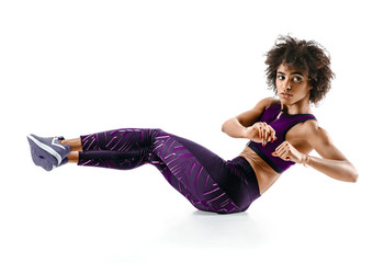 Young girl doing fitness exercise sit-ups, abs. Photo of african girl in silhouette on white...