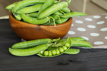 Green peas on the kitchen table.