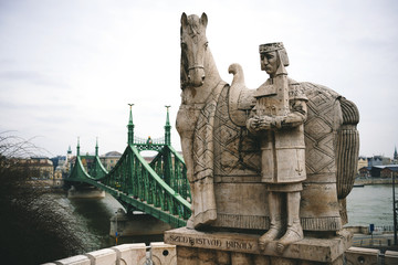 Hungary, Budapest, Stone sculpture of Saint Stephen and Liberty bridge