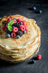 Closeup of pancakes cake with fresh berries and mint
