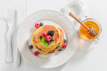 Top view of american pancakes with berries