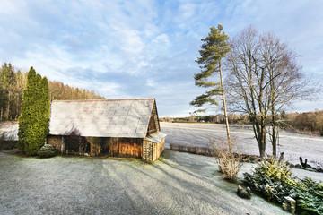 Estonia, old wooden barn in winter