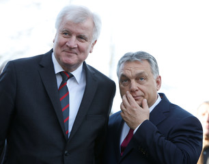 Outgoing Bavarian state premier and leader of the Christian Social Union (CSU) Horst Seehofer welcomes Hungarian Prime Minister Victor Orban before a CSU party meeting at 'Kloster Seeon' in Seeon