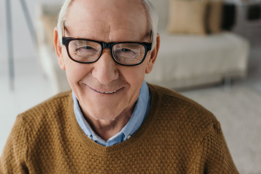Senior smiling man wearing eyeglasses and looking at camera