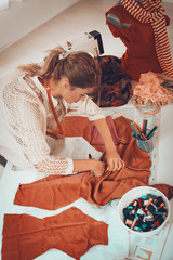 Young Woman Tailor At Work