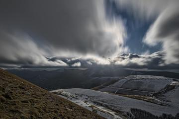 Italy, Umbria, Monti Sibillini National Park, Clouds on plateau Piano Grande of Castelluccio di Norcia