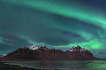 Iceland, Hoefn, Northern lights over Vesturhorn Mountains