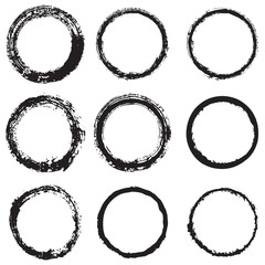 Vector set of round frames and borders, painted with an ink brush. Black grunge frame with rough edges isolated on white background. A collection of circles dirty silhouettes