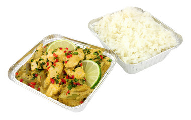 Thai green chicken curry take away meal in foil container isolated on a white background