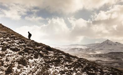 Iceland, Snaefells, hiker walking upside