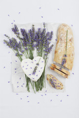 French cow's milk cheese, heart-shaped, lavender blossom, baguette on serviette