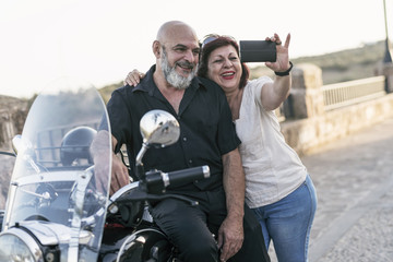 Senior couple taking selfie on sidecar bike. Jaen, Spain