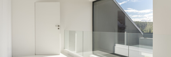 White hall wiith glass balustrade