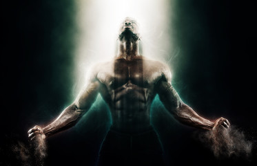 Sports wallpaper on dark background. Power athletic guy bodybuilder. Fire and energy