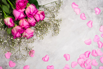 Beautiful roses on grey stone background. Valentines day or mothers day greeting card