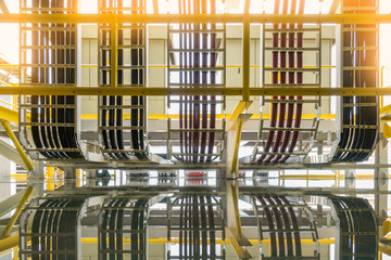 High and low voltage cables enter to transformer room, electrical power distribution system on offshore oil and gas platform.