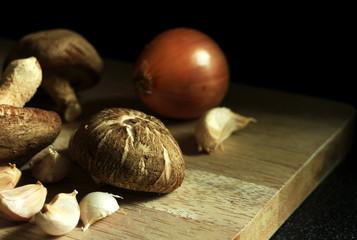 Fresh Mushroom with Garlic and Onion on Chopping Board