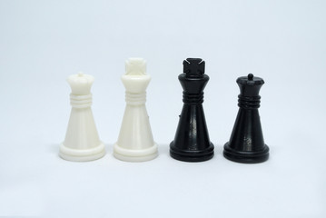 Pair of black & white chess pieces isolated on white background.