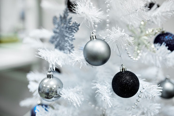 White Christmas tree with toys