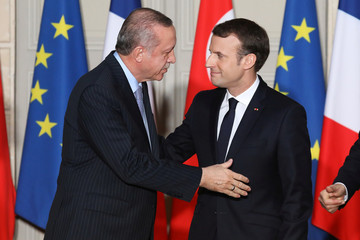 French President Emmanuel Macron greets Turkish President Recep Tayyip Erdogan during a joint press conference at the Elysee Palace in Paris