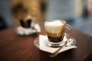 Cappuccino and espresso served on a bistro table