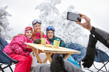 Happy family together at winter holiday on skiing