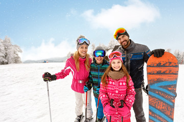 Skiers family together on skiing