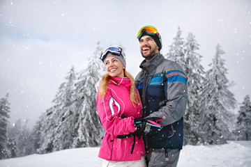 Smiling couple happy together on mountain