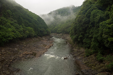 Beautiful scenery of the Katsura river along the tracks of the Sagano Scenic Railway, Kyoto, Japan