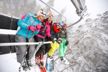 Skiers in ski lift happy together