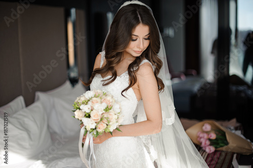 portrait of glamour bride in elegant wedding dress,veil and bouquet ...