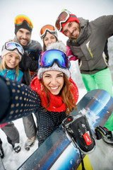 Girl with friends on skiing