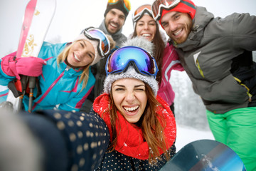 Girl on skiing with group of friends