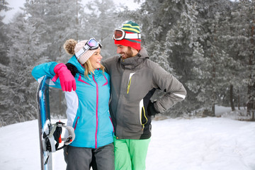Happy couple on skiing