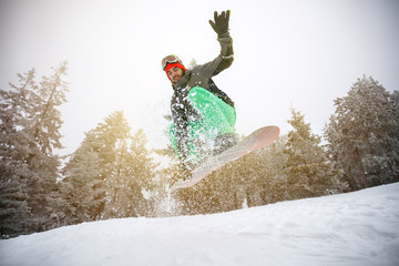 Male snowboarder in action