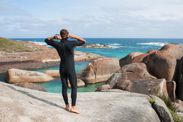 Surfer putting on his wet suit